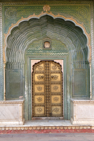 Ornate door at the Chandra Mahal, Jaipur City Palace in Jaipur, Rajasthan, India