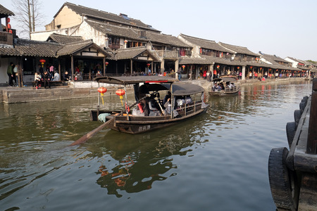 Tourist boats on the water canals of Xitang Town in Zhejiang Province, China