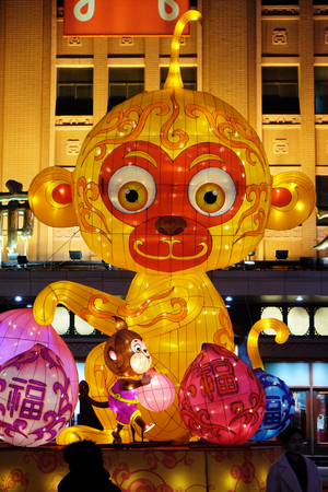 The Chinese new Year of Monkey set up in front of the luxury shopping mall at downtown in Beijing. Just before the Spring Festival and Chinese new year Editorial