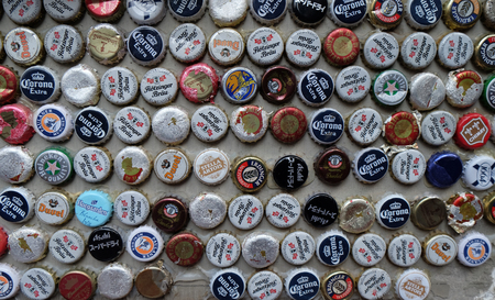 Beer bottle caps collection. Beer sales in China rose 29 percent between 2006 and 2011 to 50 billion liters, more than double the consumption in the US, the next biggest market. Shanghai