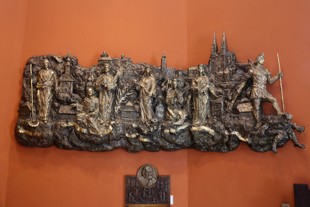 Relief with churches and patron saints of Kaptol the old part of Zagreb in Chapel of Saint Dismas in Zagreb, Croatia Editorial