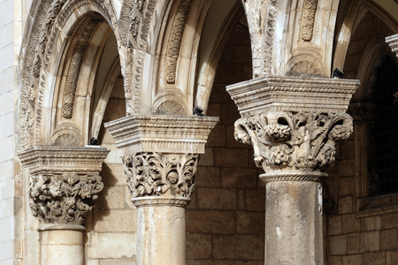 Columns and exterior of the Dukes Palace (Knezev dvor) in the Old Town of Dubrovnik, Croatia.