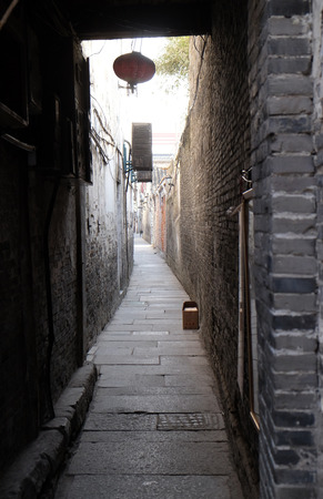 Old narrow street in Chinese water village Xitang. It is one of six destination ancient Town, located in Zhejiang Province, China