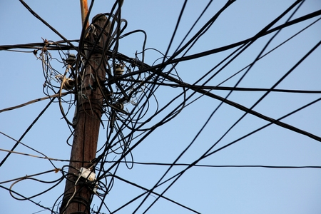 A tangle of electricity and communications cables, television aerials in Prizren, Kosovo Stok Fotoğraf