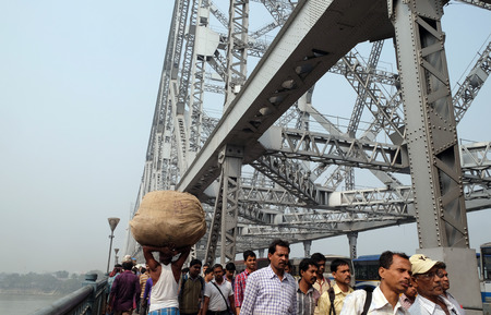 Morning rush hour, people crossing the Howrah bridge where bear more than 100,000 vehicles and 150,000 pedestrians everyday, Kolkata, India on February 10, 2016.