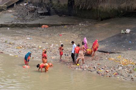 People bathing in river Hooghly under the busy Howrah bridge in Kolkata on February 10, 2016.