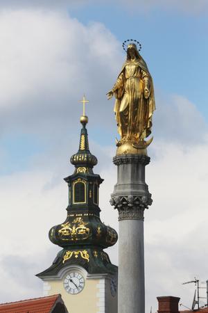 Golden statue of Virgin Mary and church of St. Mary at Tkalciceva street in Zagreb, Croatia 写真素材