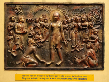 Bhagavan Mahaviras waling tour is beset with pleasant and painful distractions, Street bas relief on the wall of Jain Temple (also called Parshwanath Temple) in Kolkata, West Bengal, India Editorial