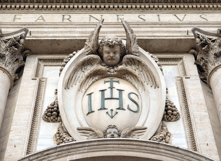 Christogram IHS, facade of the Church of the Gesu, mother church of the Society of Jesus, Rome, Italy 스톡 콘텐츠