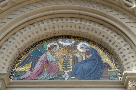 Annunciation, lunette above the entrance to the Franciscan Church of St.. Mary Mother of Mercy in Maribor, Slovenia