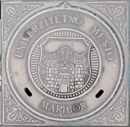 Hatch cover with the coat of arms of Maribor, Slovenia Foto de archivo