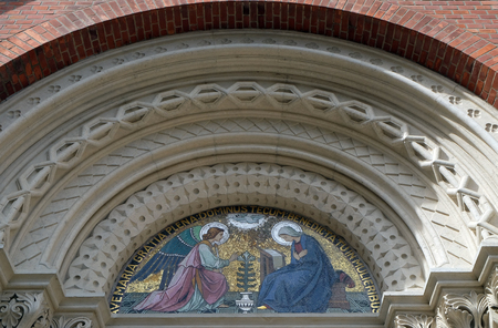 Annunciation, lunette above the entrance to the Franciscan Church of St. Mary Mother of Mercy in Maribor, Slovenia