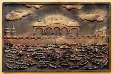 Jalmandir-Pavapuri Bihar - the place where Lord attains Nirvan, Street bas relief on the wall of Jain Temple (also called Parshwanath Temple) in Kolkata, West Bengal, India