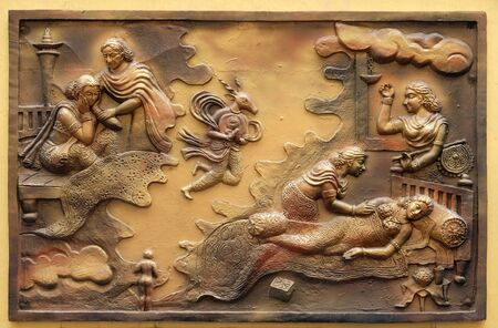 Hari-naigamesin removes the foetus from Devanandas wom and lodges in the tomb of queen Trisala, Street bas relief on the wall of Jain Temple (also called Parshwanath Temple) in Kolkata, West Bengal, I
