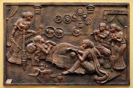 Queen Trisala witnesses fourteen great dreams signifying the advent of an omniscient saviour, Street bas relief on the wall of Jain Temple (also called Parshwanath Temple) in Kolkata, West Bengal, Ind 写真素材