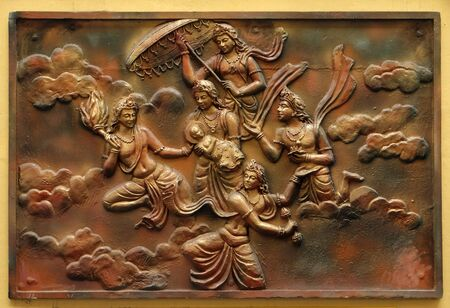 Janmakalyanaka: Birth celebration of Indra carrying Bhagavan to Mount Meru(Incident-2), Street bas relief on the wall of Jain Temple (also called Parshwanath Temple) in Kolkata, West Bengal, India 写真素材