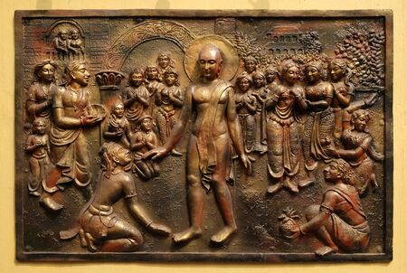 Bhagavan Mahaviras waling tour is beset with pleasant and painful distractions, Street bas relief on the wall of Jain Temple (also called Parshwanath Temple) in Kolkata, West Bengal, India 写真素材