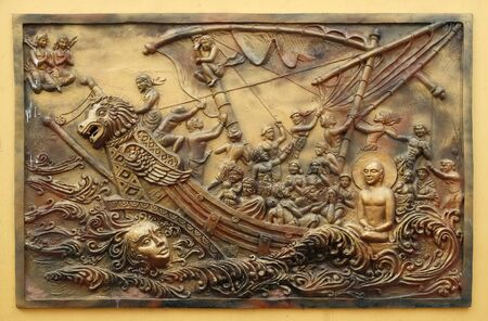 Soul itself is the strongest power; Sudamstra, a serpent-prince, creates a heavy storm in the river, but fails, Street bas relief on the wall of Jain Temple (also called Parshwanath Temple) in Kolkata 写真素材