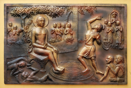 Who digs a ditch falls in it. Gosalaka hurls Tejolesya - fiery flame to burn Mahavira but he himself burnt, Street bas relief on the wall of Jain Temple (also called Parshwanath Temple) in Kolkata, West Bengal, India