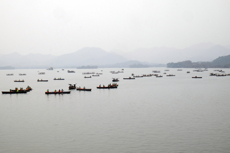 People are moving in boats on West lake in Hangzhou, China
