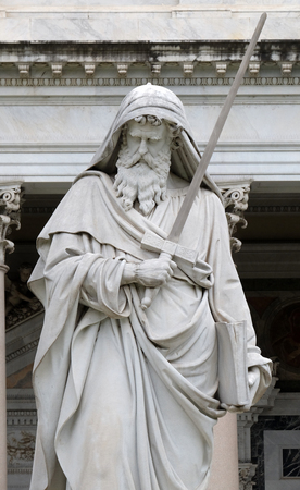 Saint Paul statue in front of the basilica of Saint Paul Outside the Walls, Rome, Italy