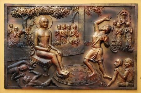 Who digs a ditch falls in it. Gosalaka hurls Tejolesya - fiery flame to burn Mahavira but he himself is burnt, Street bas relief on the wall of Jain Temple (also called Parshwanath Temple) in Kolkata, West Bengal, India