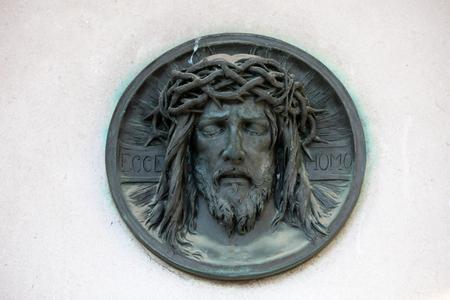 Ecce homo, Dead Christ - bronze medallion on Mirogoj cemetery in Zagreb, Croatia 写真素材