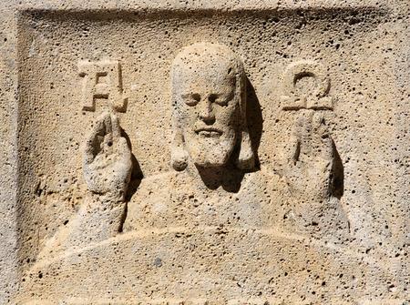 Jesus alpha and omega headstone on Mirogoj cemetery in Zagreb, Croatia
