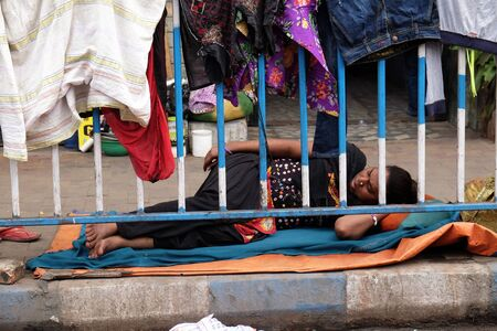 Homeless people sleeping on the footpath of Kolkata, India