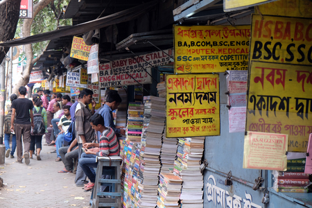 Students check out books at an old street side book stall at College Street Book Market in Kolkata, India on February 11, 2016. Stock Photo - 115892508
