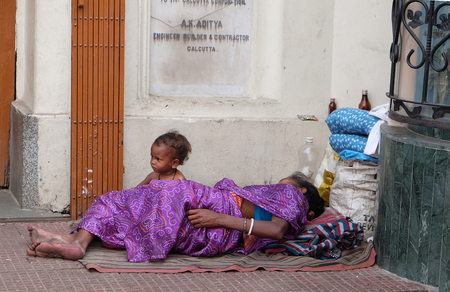 Beggars in front of Nirmal, Hriday, Home for the Sick and Dying Destitutes, established by the Mother Teresa and run by the Missionaries of Charity on February 11, 2016.