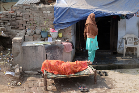 Woman sleeps in front of her house in Agra, Uttar Pradesh, India on February 14, 2016. Editorial