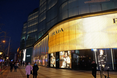 Prada flagship store exterior at night. Italian luxury goods maker Prada reported a 38 percent fall in quarterly profit, mainly caused by slowed down economic growth in China, February 23, 2016.