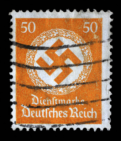 Stamp printed in Germany shows the Swastika in an oak wreath, circa 1942.