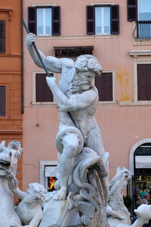 Piazza Navona, Neptune fighting with an octopus statue in the Fountain of Neptune in Rome, Italy