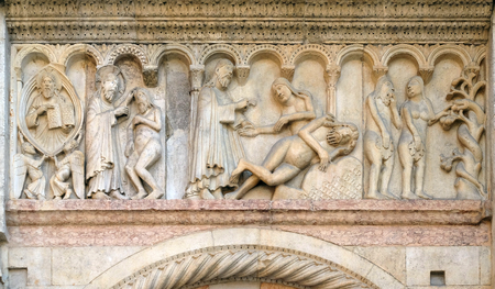 Creation Of Adam and Eve, Temptation relief by Wiligelmo, Modena Cathedral, Italy Imagens