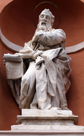 Saint Augustine statue on the portal of St. Barbabas Church, Italy