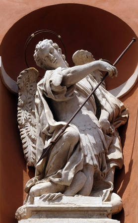 Saint Michael statue on the portal of St. Barbabas Church, Italy