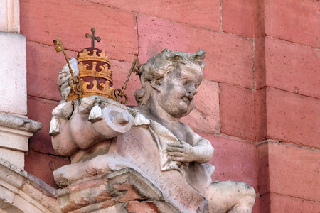 Angel statue on the portal of Our Lady church in Aschaffenburg, Germany