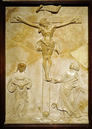 Crucifixion with Mary and Saint John by Sebastian Loscher, marble relief, 16 century, the Passion in Art from Mimara Museum in Zagreb, Croatia