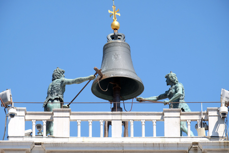 The bell on top of an ancient Clock Tower Torre dell`Orologio in the Piazza San Marco, Venice, Italy