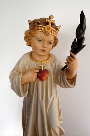 Infant Jesus, king of the world with sacred heart, statue in the Church of Visitation of the Virgin Mary in Sisak, Croatia