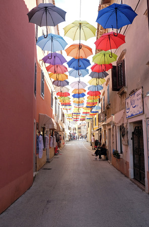 Umbrellas on a shopping street in the old town of Novigrad, Croatia
