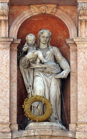 Virgin Mary with baby Jesus, statue on Piazza delle Erbe Market`s square in Verona, Italy