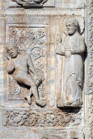Creation of Adam, medieval relief on the facade of Basilica of San Zeno in Verona, Italy