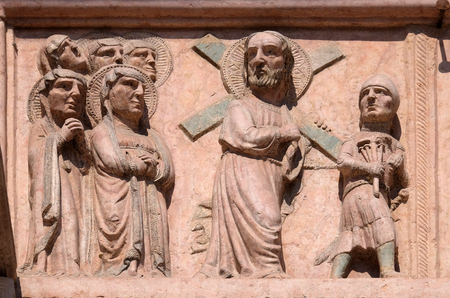 Path towards the Calvary, relief on Facade of Saint Anastasia Church in Verona, Italy