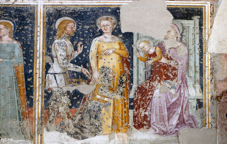 Enthroned Madonna and Child, Saint George, a Saint and a worshipper Knight, fresco in the church of San Pietro Martire in Verona, Italy