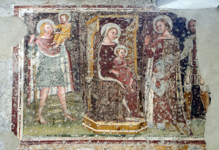 Enthroned Madonna and Child, Saints Christopher, Catherine, George and a worshipper Knight, fresco in the church of San Pietro Martire in Verona, Italy