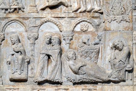 Annunciation, Visitation and Birth of Jesus, medieval relief on the facade of Basilica of San Zeno in Verona, Italy