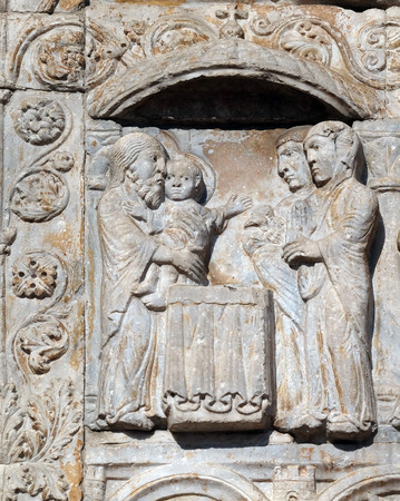 Presentation of Jesus in the Temple, medieval relief on the facade of Basilica of San Zeno in Verona, Italy Stock Photo
